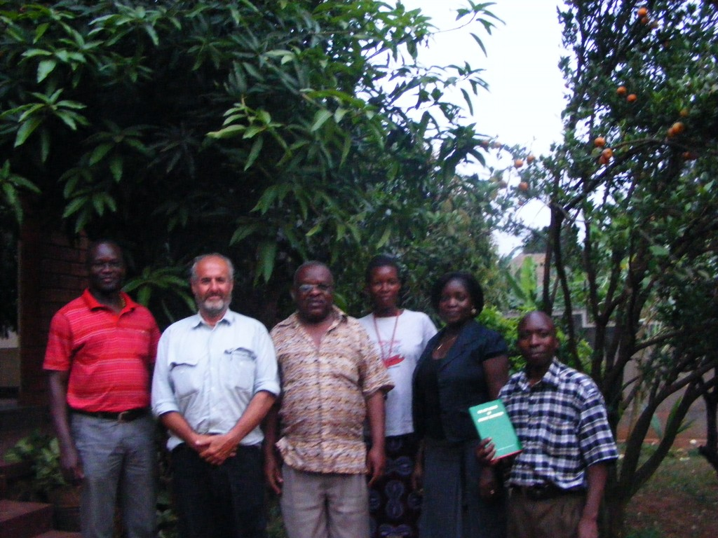 Richard with Ugandan ex-minister of Water and the Environment with family and head of the Church