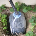 black water collection bottle placed outside the toilet housing